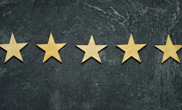 Five gold stars on a black background.