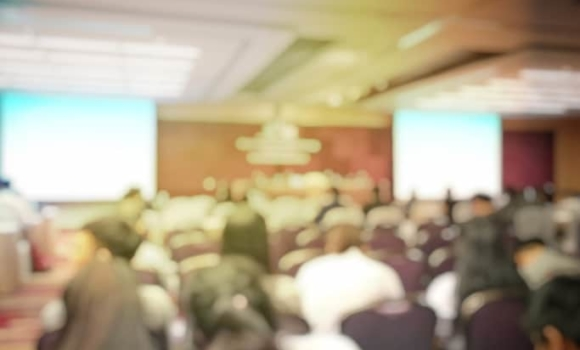 abstract background on audience at a conference