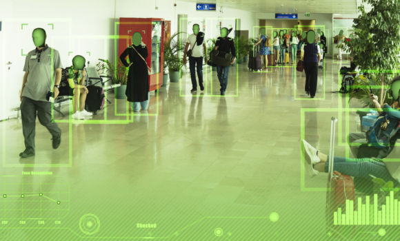 Facial recognition software scans room of people.