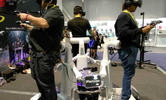 People at CES using Virtual Reality gear