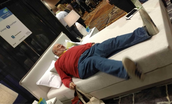Person on a sleep number bed