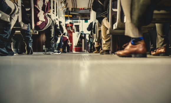 People feet on a train