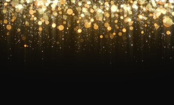 Gold circles glitter on a black backdrop.