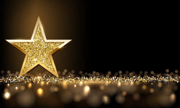 Golden sparkling star isolated on dark luxury horizontal background.