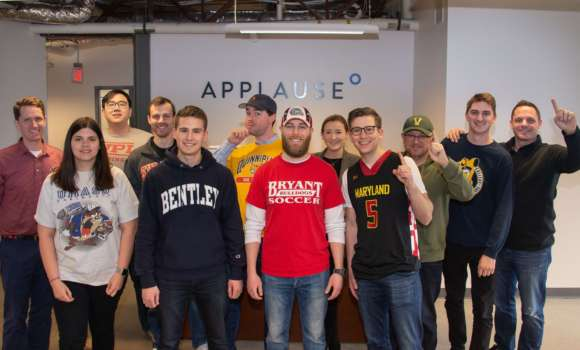 Applause team members wear their university colors during March Madness.