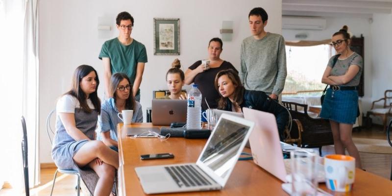 Group Of People Watching Video On Macbook
