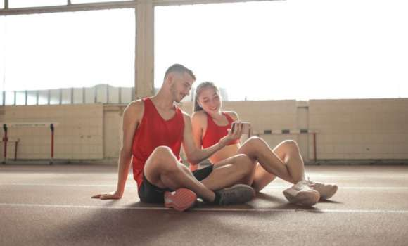 Couple resting during workout