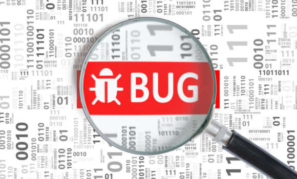 An image of a software bug under a magnifying glass.