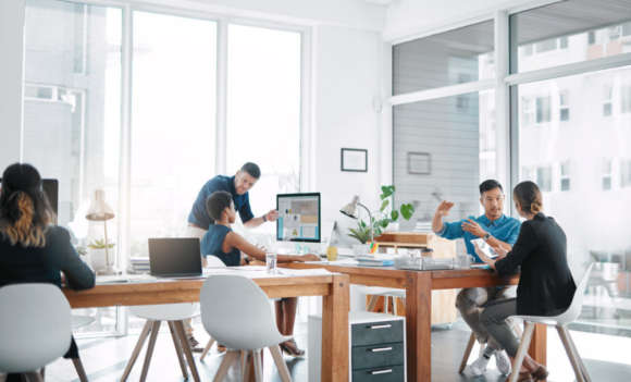 QA team works around a desk