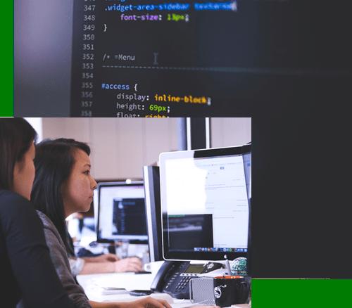 Frauen arbeiten an Computern mit Code